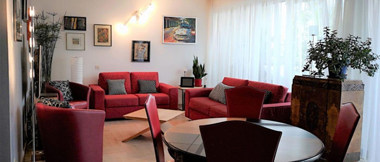 Salon rouge décoration intérieur muda creations